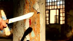 Cleaning bloody knife Stock Footage
