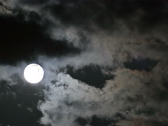 4K UHD Time Lapse Full moon rising in the cloudy dark sky Stock Footage