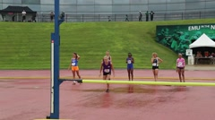 Blonde Girl Clears the High Jump Bar  Stock Footage