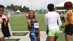 African/American Girls at Track Even Wave to Camera Stock Footage