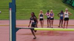 African/America Teenage Girl Clears High Jump Bar Stock Footage