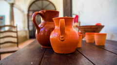 Clay pot on the wooden table in the Middle Ages - stock footage
