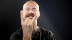 Bald man with beard gesturing Stock Footage