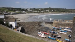 Boats beach and harbour Coverack Cornwall England UK - stock footage
