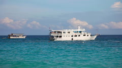 Divers ship ancored not far from the shore. Similan Islands, Thailand. - stock footage