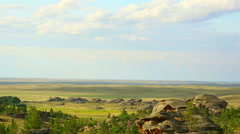 Beautiful time lapse shot of clouds moving over the Kazakh steppe. - stock footage