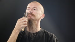 Bald man brushing long beard Stock Footage