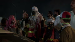 Police fire Live Bullets and Teargas on Anti Govt. Protests in Islamabad Stock Footage