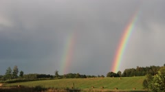 Two rainbows in the sky. Double rainbow - stock footage