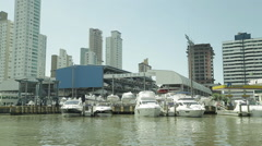 Boats in the marina building with the background in sunny day Stock Footage