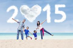 family at beach under cloud of 2015 - stock illustration