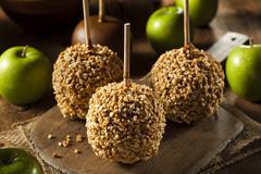 Homemade taffy apples with peanuts Stock Photos