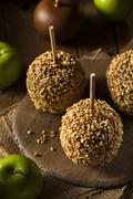 homemade taffy apples with peanuts - stock photo