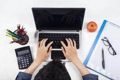 student with laptop and school stationery - stock photo