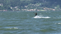 Kitesurfer navigating on a lake  - stock footage