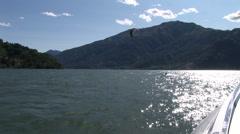 Kitesurfer navigating on a lake  Stock Footage