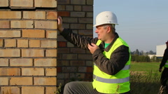 Building inspector with walkie-talkie Stock Footage
