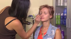 Makeup for young beautiful redhad girl Stock Footage