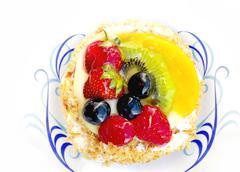 Creamy pastry fruit cake entree dessert on plate closeup Stock Photos