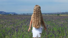 Little girl go away from camera. The child goes into the distance. Schoolgirl Stock Footage