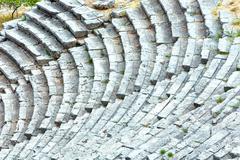 An ancient amphitheater (greece) Stock Photos