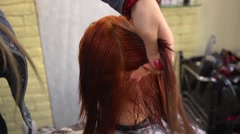 Cutting her red hair in a salon of beauty Stock Footage