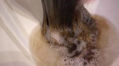 In a hairdressing salon washing away of paint from hair Stock Footage
