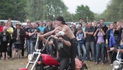 Bikers and topless girls on rock concert open air Stock Footage