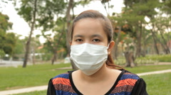 Woman wear surgical mask. Stock Footage