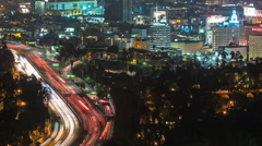 Hollywood Night Aerial Timelapse. Freeway to City Buildings Stock Footage