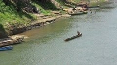 Man Paddles Traditional Canoe on Central American River Stock Footage