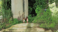 Young Girls Playing at the River's Edge Stock Footage