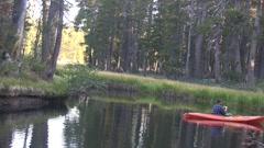 Kayaker baiting hisfishing hook Stock Footage