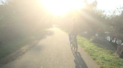 Slow Motion Bicycle Rider Sunset - stock footage