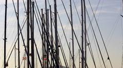 Boat masts at harbor at sunset. Stock Footage