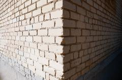 Wide angle view of the corner of a building made of white bricks, shadow and Kuvituskuvat