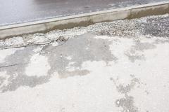 Asphalt  footway and border (parapet) as background for your design, a lot of - stock photo