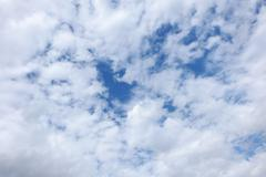 Blue sky covered with clouds, only some blue spots in the center Stock Photos