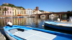 Bosab HDBlue boat floating near a dock at Bosa, Sardinia, Italy. Stock Footage