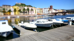 Boats in a row docked at Bosa, Sardinia, italian little village. Stock Footage