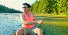 4K Active Man Enjoying Warm Summer Day in Canoe Stock Footage
