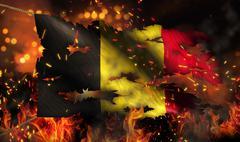 belgium burning fire flag war conflict night 3d - stock illustration