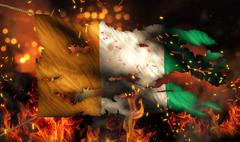 cote d'ivoire burning fire flag war conflict night 3d - stock illustration