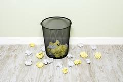 wads of paper and trashcan - stock photo