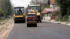 Road rollers flattens asphalt. Paving. Asphalting. Steamrollers. Road work. Stock Footage