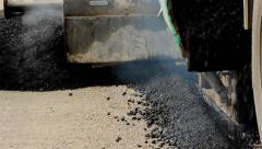 Machine for paving apply asphalt to road. Asphalting. Road works. Close up. Stock Footage