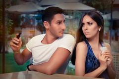 Secretive Couple with Smart Phones in Their Hands Stock Photos