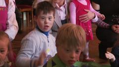 Children with developmental delays play at the medical center - stock footage