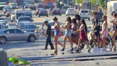 Crowd of people crossing street reflecting in hot air Slow motion. Los Angeles Stock Footage
