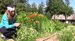 Turn view girl reap organic camomile and grandma uproot herbal Stock Footage
